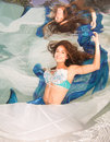 Model In A Pool Wearing A Mermaid`s Tail. Royalty Free Stock Image - 92621216