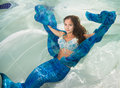 Model In A Pool Wearing A Mermaid`s Tail. Royalty Free Stock Photos - 92621298