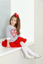 Little Girl Sitting At A Window Sill. Royalty Free Stock Photo - 92624225