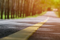 Blurred Lonely Road Picture With Warm Sunlight. Empty Barren Natural Places Good For Scenic Drives With Your Free Time Or Weekend Royalty Free Stock Photography - 92627447