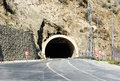 Entrance To Road Tunnel With Traffic Signs Stock Images - 92633294
