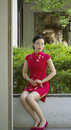 Chinese Cheongsam Model In Chinese Classical Garden Royalty Free Stock Photo - 92634345