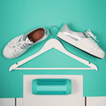 Flat Lay Of Modern White Shoes. Overhead Top View Photography. Youth Lifestyle Concept. Turquoise Background Royalty Free Stock Image - 92643396