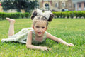 Beautiful Little Girl Lying On The Grass Royalty Free Stock Image - 92643886