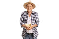Elderly Farmer Holding A Small Duckling Royalty Free Stock Image - 92648726
