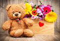 Flowers In The Box And A Teddy Bear Royalty Free Stock Photo - 92696695