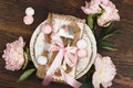 Light Pink Peonies And Tableware On The Wooden Table Stock Image - 92726461