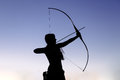 Female Ginger Hair Archer Shooting Targets With Her Bow And Arrow. Concentration, Target, Success Concept. Stock Photos - 92730463