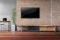 Living Room Tv On Red Brick Wall With Wooden Table Stock Photo - 92735270