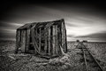 Old Fishing Net Huts On A Pebbled Beach With Dramatic Long-expos Stock Photos - 92742623