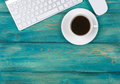 Office Desk With Copy Space. Digital Devices Wireless Keyboard And Mouse On Red Wooden Table With Cup Of Coffee, Top View Royalty Free Stock Image - 92775236