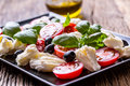 Caprese Salad.Mediterranean Salad. Mozzarella Cherry Tomatoes Basil And Olive Oil On Old Oak Table. Italian Cuisine Royalty Free Stock Images - 92784149