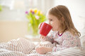 Pretty Sick Little Child Girl Laying In Bed Drink Tea Royalty Free Stock Photo - 92788035