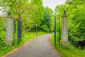 Open Wrought Iron Gate Between Two Stone Pillars Stock Images - 92807834