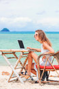 Young Sexy Woman Using Laptop On The Beach. Freelance Work Royalty Free Stock Photos - 92811318