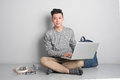 Young Asian Man In Casual Clothes Is Using A Laptop, Smiling Whi Stock Photo - 92898490