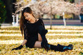 Beautiful Girl In Black Vintage Dress And Hand Glove. Woman In Retro Dress Playing In The Park With Ginko Leafs. Red Lips Stock Photo - 92903310