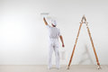 Rear View Of Painter Man Painting The Wall, With Paint Roller An Stock Photos - 92914093