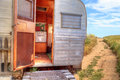 Small Retro Caravan Camper Used As A Tiny House On Road Trips Stock Photos - 92928133