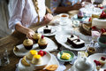 Friends Gathering Together On Tea Party Eating Cakes Enjoyment H Royalty Free Stock Image - 92940666