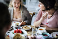 Friends Gathering Together On Tea Party Eating Cakes Enjoyment H Stock Image - 92940861