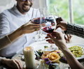 People Clinging Wine Glasses Together In Restaurant Royalty Free Stock Photo - 92940875