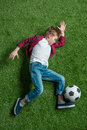 Boy With Soccer Ball Lying On Green Grass Royalty Free Stock Photos - 92945458