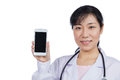 Asian Female Doctor Using Mobile Phone Stock Photo - 92958110