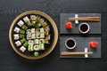 Set Of Sushi Maki And Rolls On Black Rustic Wood, Top View Stock Photos - 92962473
