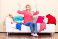Woman Does Not Know What To Wear Sitting On Couch Stock Images - 93003404