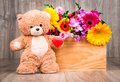 Flowers In The Box And A Teddy Bear Royalty Free Stock Photography - 93006557