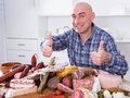 Ordinary Men With Lots Of Meat And Sausage Products Royalty Free Stock Photography - 93028037
