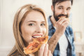 Couple Eating Delicious Pizza Stock Image - 93032861