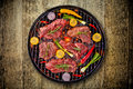 Top View Of Fresh Meat And Vegetable On Grill Placed On Wooden Floor Royalty Free Stock Images - 93038459