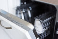 Close Up Of Open Dishwasher With Clean Utensils Stock Photo - 93164360