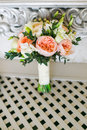 Bridal Bouquet Near The White Vintage Wall On The White Wooden Floor Royalty Free Stock Images - 93171469