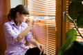 Beautiful Girl Looks Out Of The Window Royalty Free Stock Image - 9320286