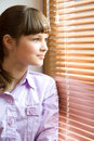 Beautiful Girl Looks Out Of The Window Royalty Free Stock Photos - 9320298
