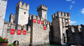 View Of The Medieval Scaliger Castle Of Sirmione With Signboard Of Italian Rally Mille Miglia And Speedboat Passing, Sirmione, Ita Stock Image - 93215781