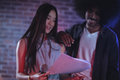 Male And Female Performers Reading Papers In Nightclub Royalty Free Stock Image - 93238876