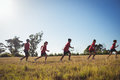 Group Of Kids Jogging In The Boot Camp Royalty Free Stock Photo - 93240595