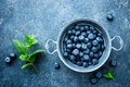 Fresh Blueberries In A Bowl On Dark Background, Top View. Juicy Wild Forest Berries, Bilberries Stock Image - 93272771