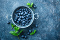 Fresh Blueberries In A Bowl On Dark Background, Top View. Juicy Wild Forest Berries, Bilberries Stock Photo - 93272780