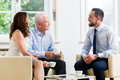 Financial Advisor Consulting Couple In Retirement Planning Stock Photo - 93294300