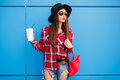 Portrait Of Beauty Fashion Smiling Woman With Coffee In Sunglasses On Blue Background. Outdoor. Copy-space. Red Bag Royalty Free Stock Photography - 93301817