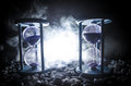 Time Concept. Sand Passing Through The Glass Bulbs Of An Hourglass Measuring The Passing Time As It Counts Down To A Deadline. Sil Stock Photo - 93303560