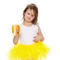 The Little Girl In The Yellow Skirt Eating A Banana. Stock Photography - 93303962