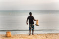 A Fisherman On The Beach Is Going To Throw Nets.Sri Lanka,  Kalk Royalty Free Stock Images - 93321549