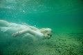 A Floating Woman. Underwater Portrait. Girl In White Dress Swimming In The Lake. Green Marine Plants, Water Stock Image - 93324331