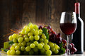 Composition With Glass, Bottle Of Red Wine And Fresh Grapes Stock Images - 93331244